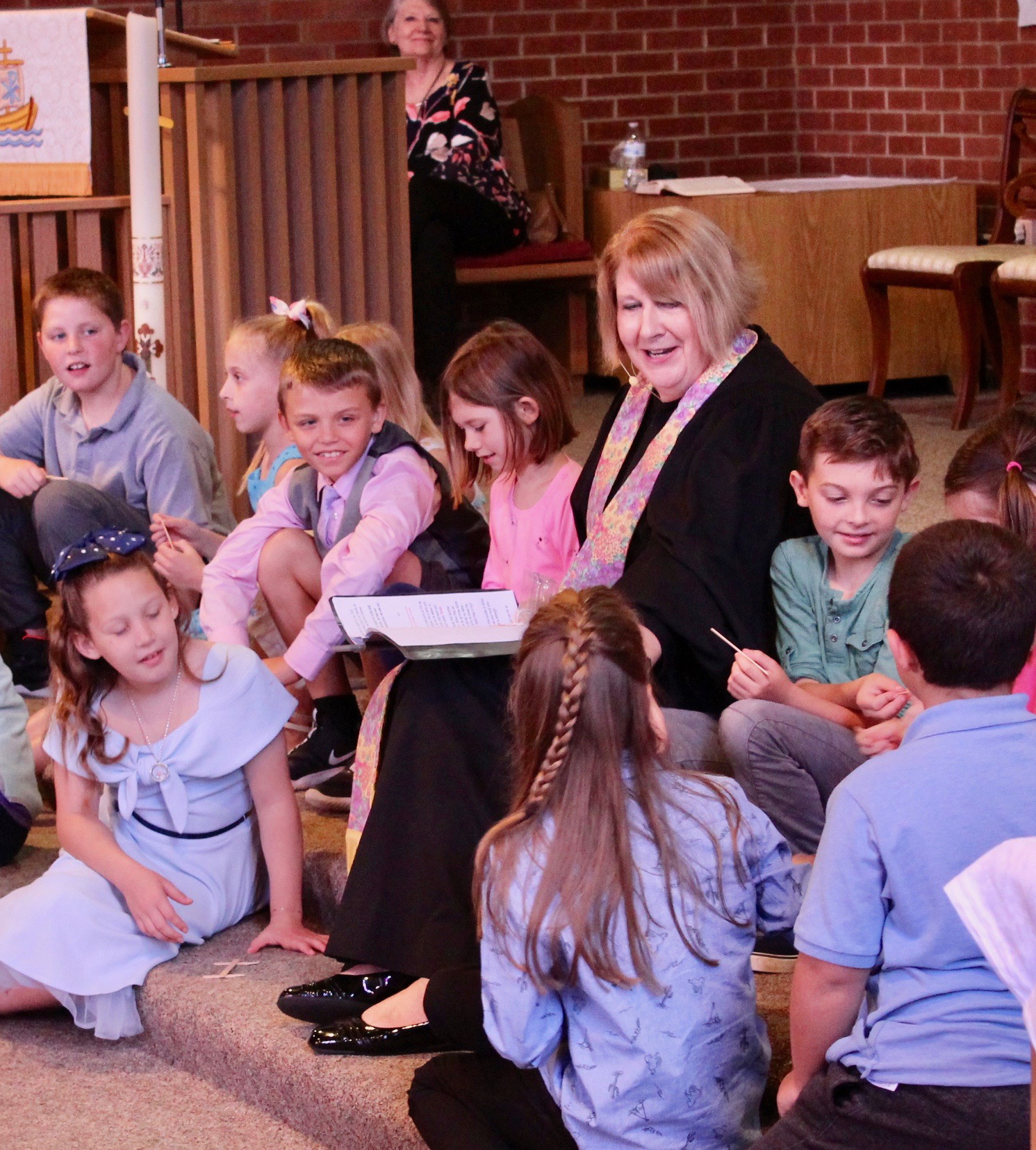 Pastor Vicki with children on chancel steps